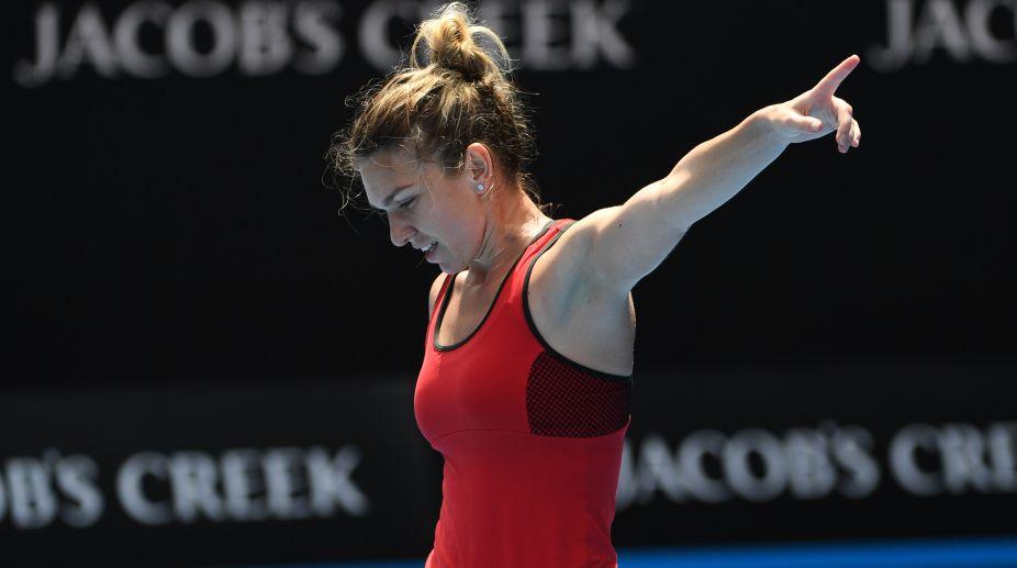 Romania's Simona Halep celebrates beating Lauren Davis of the US in their women's singles third round match (Photo Credit- AFP)