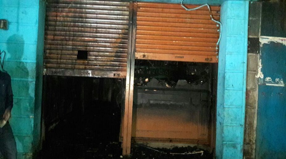 Bengaluru: Five persons were charred to death when a fire broke out in a Kailash Bar and Restaurant at K R Market in Bengaluru on Jan 8, 2018. The victims were asleep on the ground floor of the building. (Photo: IANS)