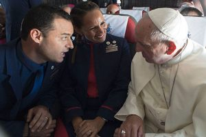 In a first, Pope Francis reads out wedding vows for couple on Chile flight