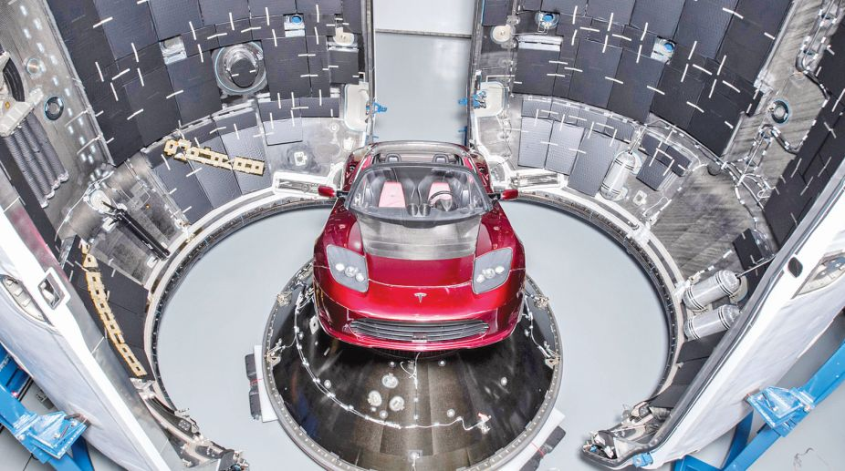 The cherry red Tesla Roadster inside the Falcon Heavy (Photo: SNS)