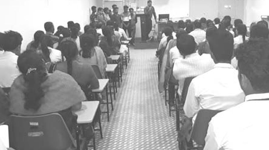 A meeting with parents and guardians being conducted by Principal, P K Mishra at the Surya sen College in Siliguri on Monday. (Photo: SNS)