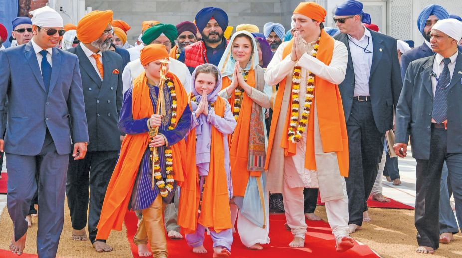 Canadian Prime Minister Justin Trudeau, third right, walks with his family members during their visit to Golden Temple, in Amritsar, India, Wednesday, Feb. 21, 2018. Trudeau is on a seven-day visit to India.