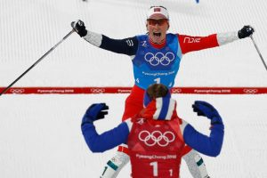 Bjoergen becomes most successful winter Olympian with 14 medals