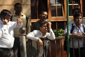 Sensex recovers over 700 points to close day at 561 points lower