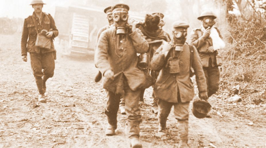German prisoners wear gas masks in Ypres, France in an April, 1915 file photo.Gas warfare, which recently killed hundreds of people in Syria, actually began on a sunny morning almost a century ago, and among its first victims were hundreds of Canadians. (Photo: THE CANADIAN PRESS/AP)