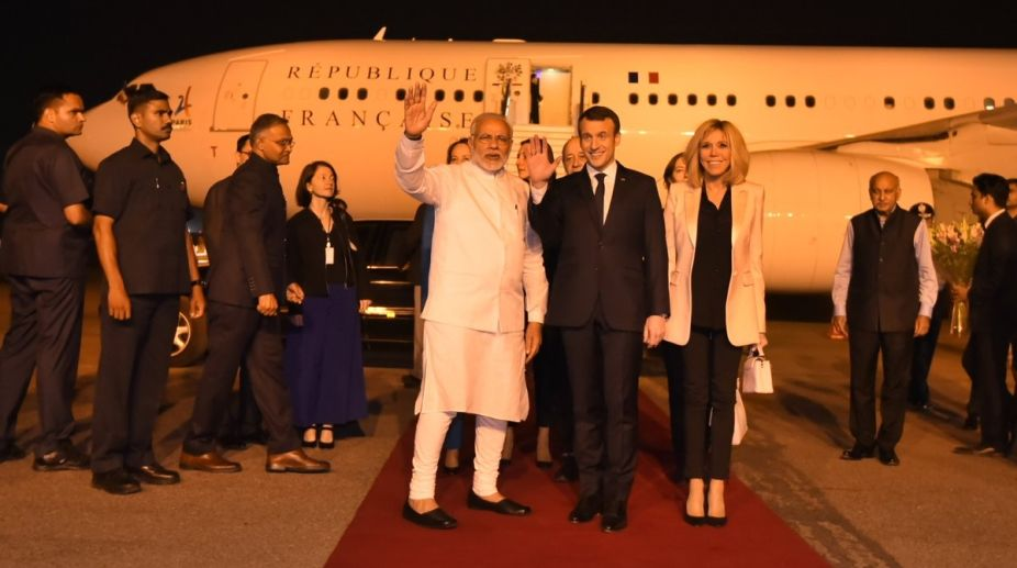 Prime Minister Narendra Modi greets French President Emmanuel Macron on his arrival in New Delhi on March 9, 2018. (Photo: IANS)