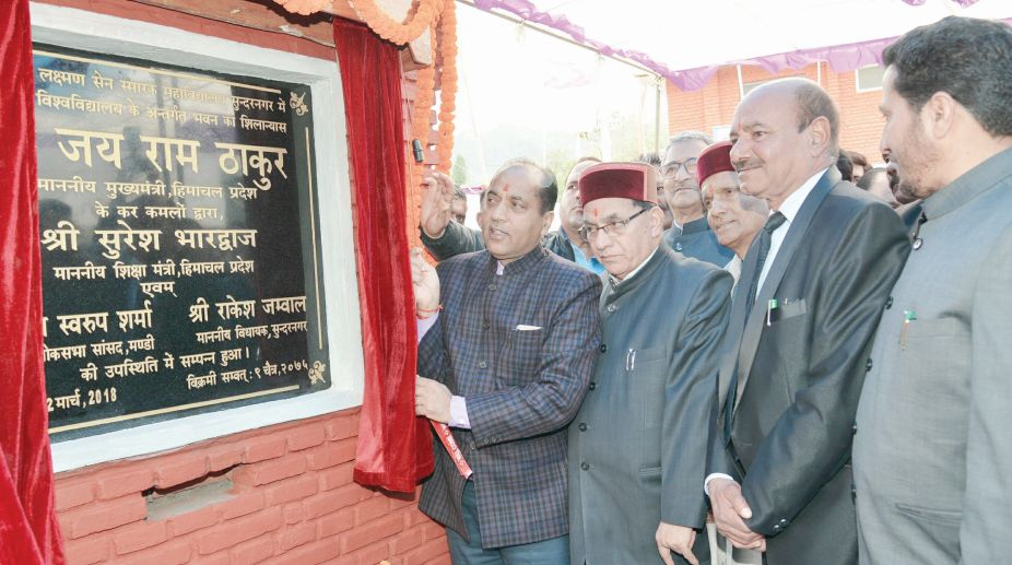 Chief Minister Jai Ram Thakur laying the foundation stone of cluster college building of MLSM College at Sunder Nagar in District Mandi on Thursday. (Photo: SNS)