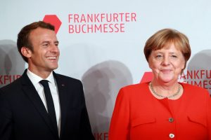 Macron, Merkel pledge common roadmap on eurozone reforms