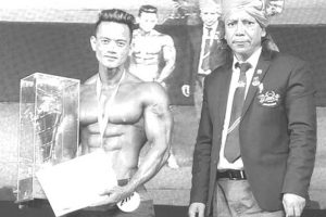 Hill man strikes gold in body-building contest