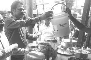 Raiganj shops given dust bins to keep town clean