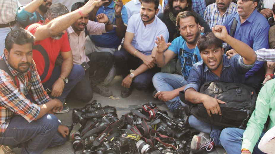 Journalists during their protest against alleged police excesses, in the Capital on Saturday. (Photo: Ritik Jain)