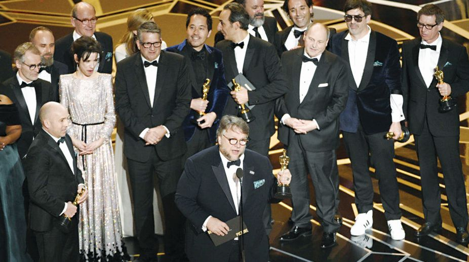 Director Guillermo Del Toro (centre) with the cast and crew of The Shape of Water after winning the Best Film award.