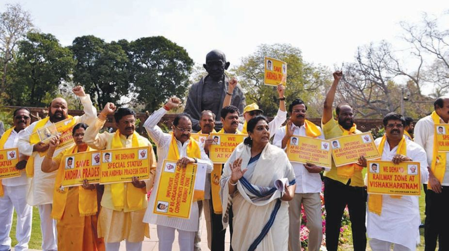 Congress MP Renuka Chowdhury looks on as TDP MPs stage a demonstration to press for special economic status for Andhra Pradesh at Parliament in New Delhi on March 19, 2018. (Photo: IANS)
