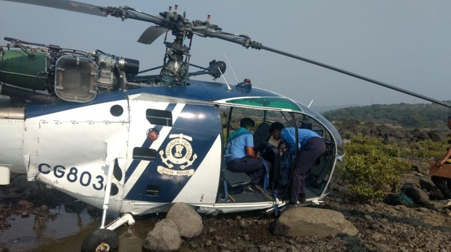 Coast Guard pilot, who suffered injuries in chopper crash, dies