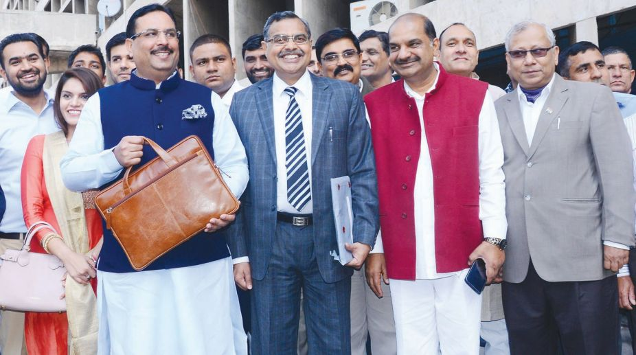 Haryana Finance Minister, Captain Abhimanyu on his way to Vidhan Sabha to present Budget for the Year 2018-19 in the ongoing Budget Session of State Assembly in Chandigarh on March 9, 2018. Haryana Additional Chief Secretary, Finance, Mr. P. Raghavendra Rao is also seen in the picture. (Photo: SNS)