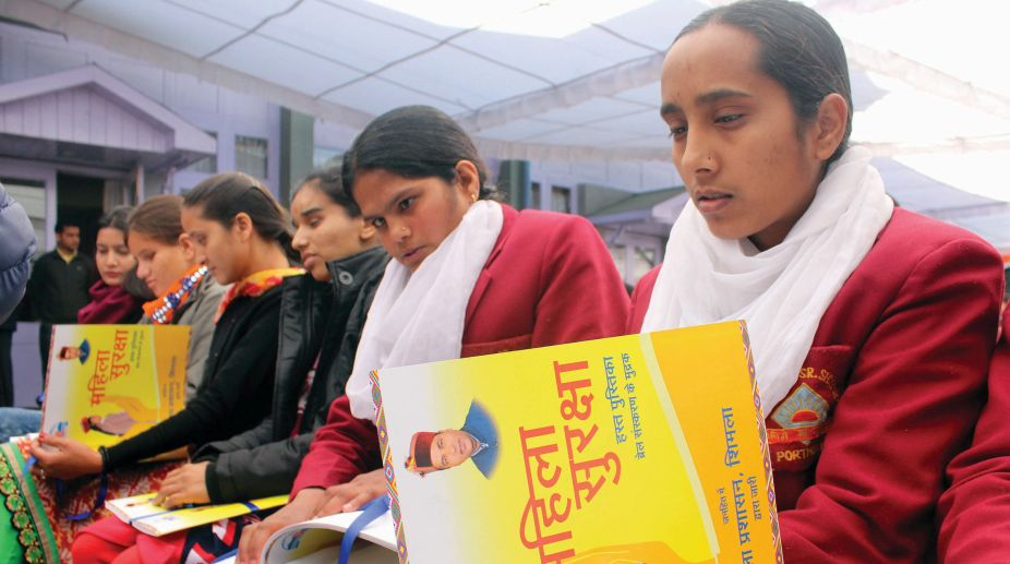 Blind girls from Portmore School and Himachal Pradesh University going through the women safety handbook in Braille. (Photo: SNS)