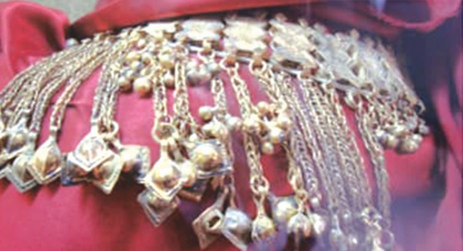 A close-up of a gold belt