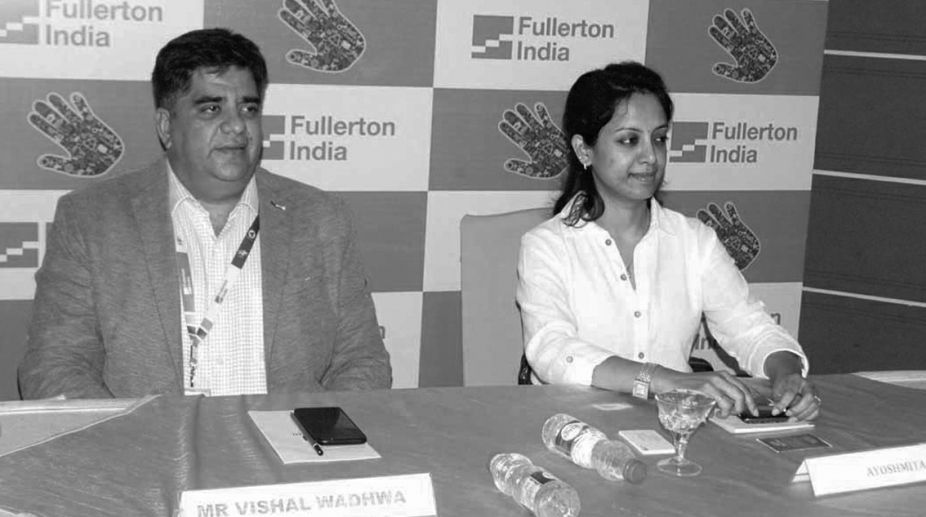 Mr Vishal Wadhwa and Ayoshmita of Fullerton India Credit Co. address a press conference in Bhubaneswar on Wednesday. (Photo: SNS)