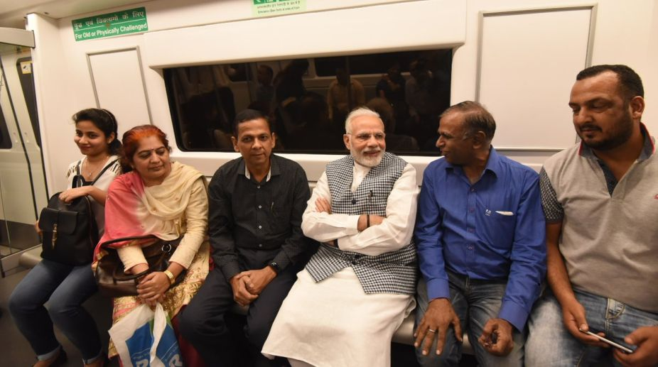PM Modi takes metro to reach to attend Ambedkar's birth anniv event