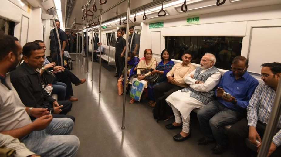 PM Modi surprises metro commuters, inaugurates Ambedkar Memorial