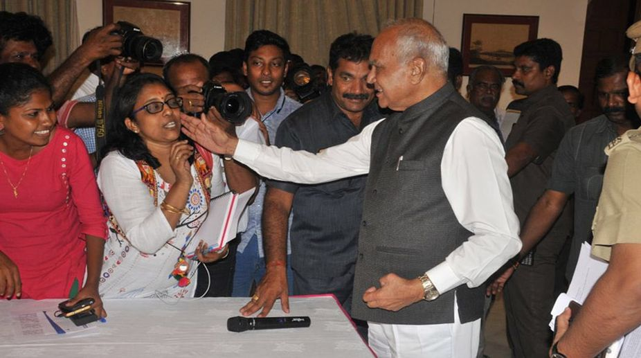 Tamil Nadu Governor pats senior woman journalist on cheek