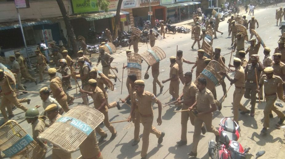 Tuticorin: Police personnel carry out baton charges to bring the protesters under control during protests for the closure of Vedanta's Sterlite copper smelter in Tamil Nadu's Thoothukudi district; in Tuticorin on May 22, 2018. Nine people, including a girl, died on Tuesday in police firing after the ongoing anti-Sterlite protests turned violent with hundreds of people from nearby areas allegedly attacking the District Collectorate demanding closure of the Vedanta Group-run company. (Photo: IANS)