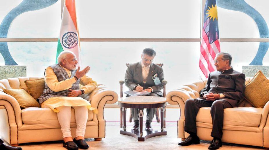 PM Modi meets Malaysian counterpart Mahathir Mohammad