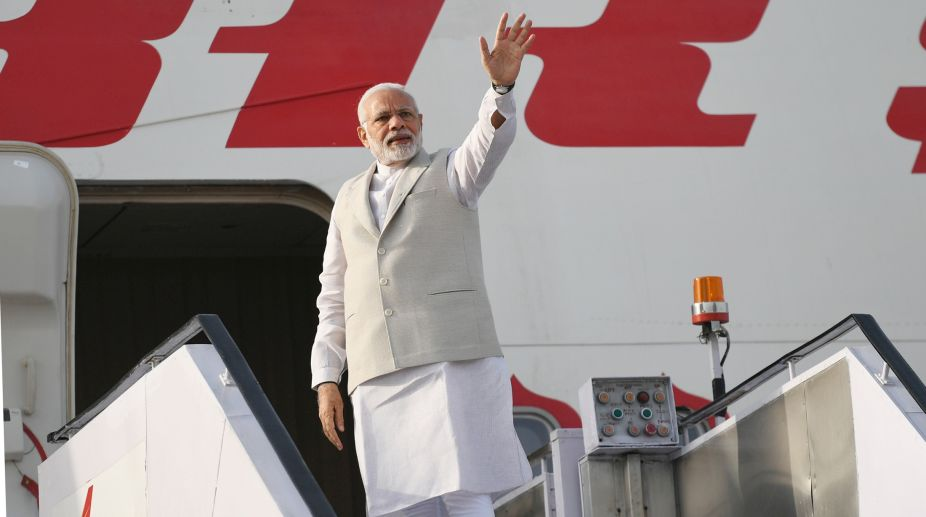 Modi visits, Narendra Modi, Act East Policy, Singapore, Indonesia