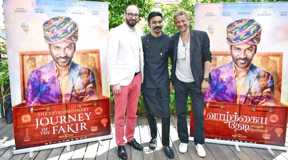 Actor Dhanush (centre) with the makers of The Extraordinary Journey of the Fakir
