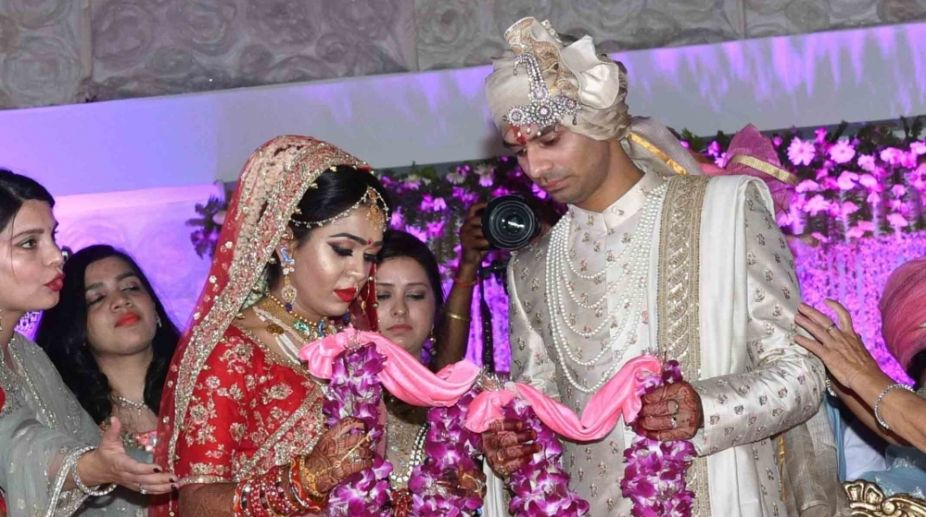 Patna: RJD leader Tej Pratap Yadav ties knots with Aishwarya Rai in Patna on May 12, 2018. (Photo: IANS)