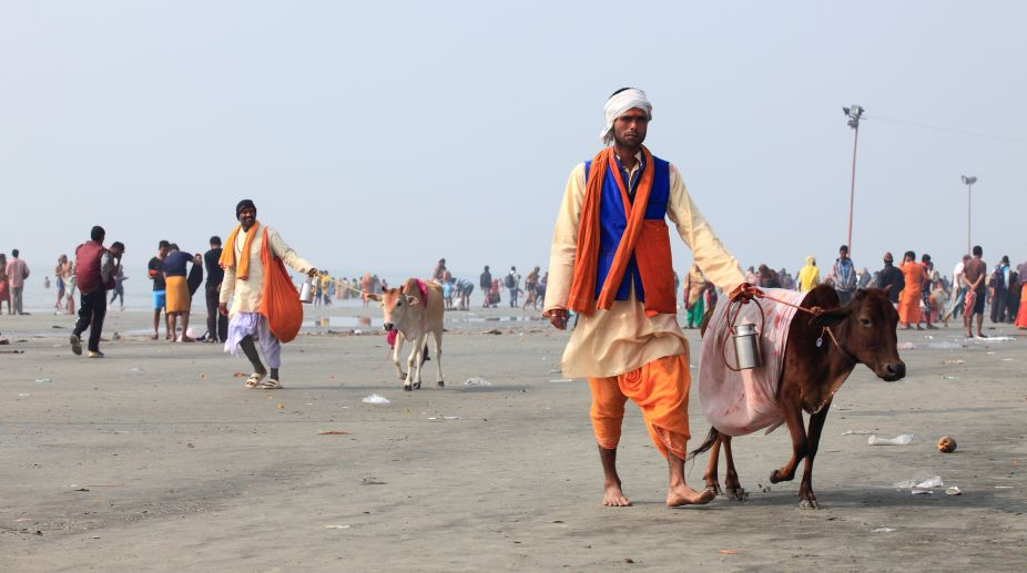 Gangasagar, India -January 14,2018 : Unidentified Hindu pilgrims gathered to take a holy dip in Ganges on the day of 'Makar Sankranti' in Gangasagar Islands, West Bengal,India.