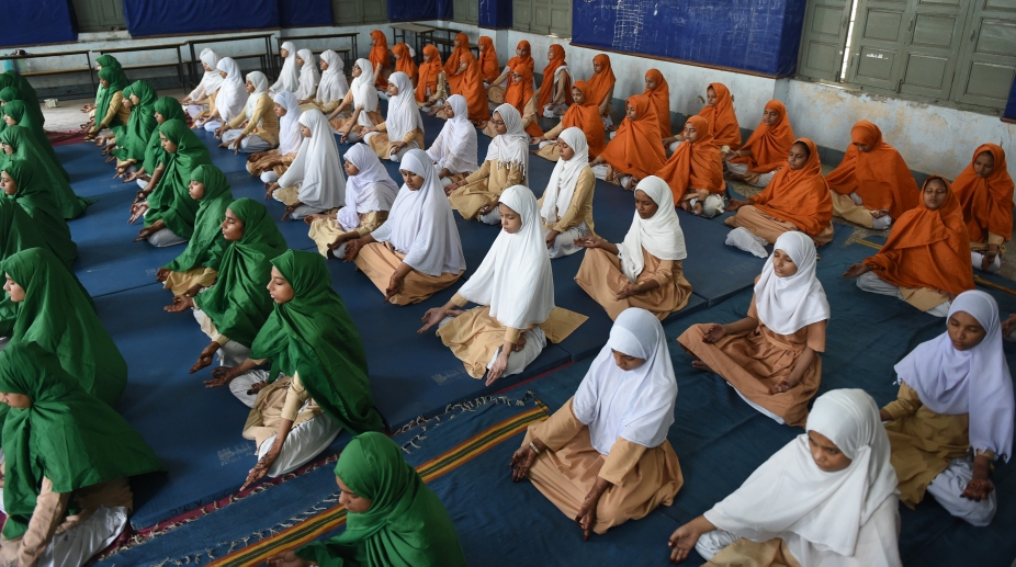 Students from Anjuman-E-Islam school participate in a Yoga rehearsal ahead of International Yoga Day on Tuesday, 19 June 2018