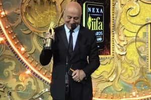 Anupam Kher dedicates award to struggling actors without godfathers