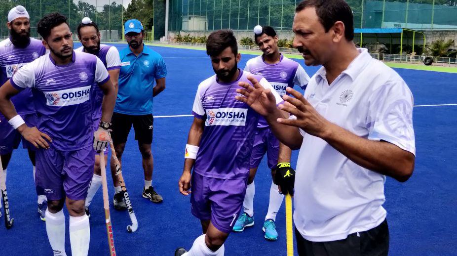 Chief Coach Harendra Singh talks to team