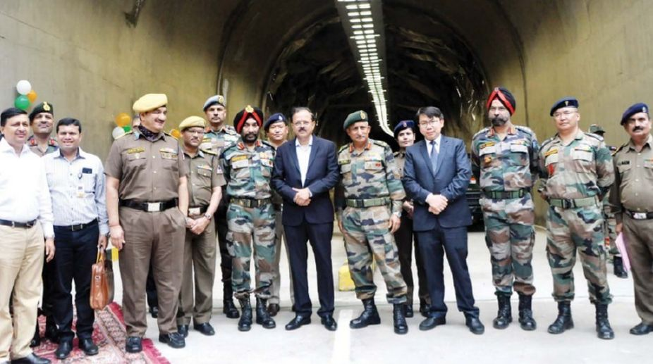 Minister of State for Defence, Dr Subhash Ramrao Bhamre, poses with officers of the Army and Border Roads Organisation after inaugurating the 578-metre-long 'Theng Tunnel' at Theng in North Sikkim on Thursday. (Photo: SNS)
