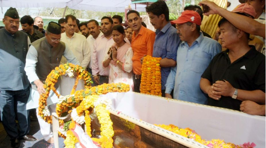 Uttarakhand Chief Minister Trivendra Rawat paying tributes to martyred soldier Vikas Gurung in Rishikesh on Monday.