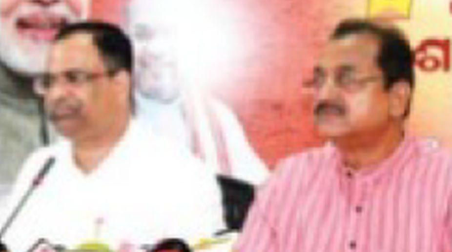 BJP spokesperson Pitambar Acharya addressing media persons in Bhubaneswar. (Photo: SNS)