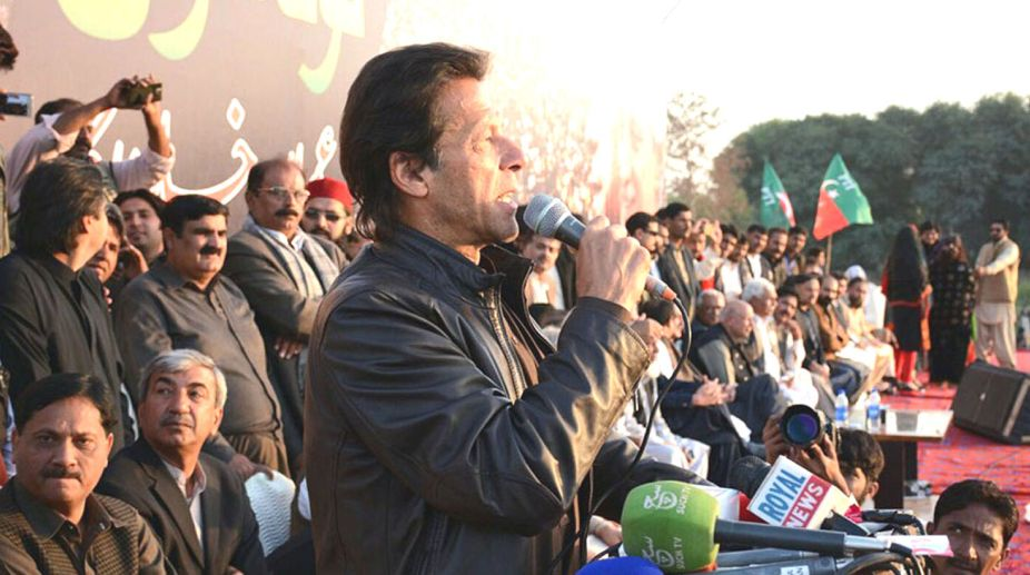 Lodhran: 15th Dec - PTI Chairman Imran Khan addressing a political gathering in Lodhran for the by election campaign in NA-154. - DNA Photo