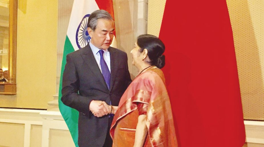 External Affairs Minister Sushma Swaraj meets China's State Councilor and Foreign Minister Wang Yi on the sidelines of the BRICS (Brazil, Russia, India, China, South Africa) Ministerial Meeting in Pretoria, South Africa on June 4, 2018. (Photo: IANS/MEA)