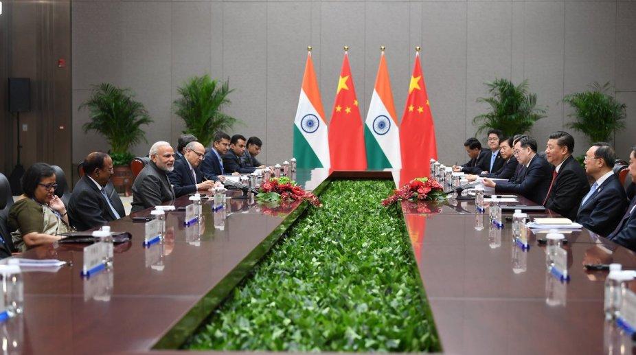 Xi Modi meet in Qingdao