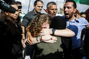 Jailed for slapping Israeli soldiers, Palestinian teenager Ahed Tamimi freed after 8 months