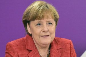 Angela Merkel averts coalition government spilt over migrants