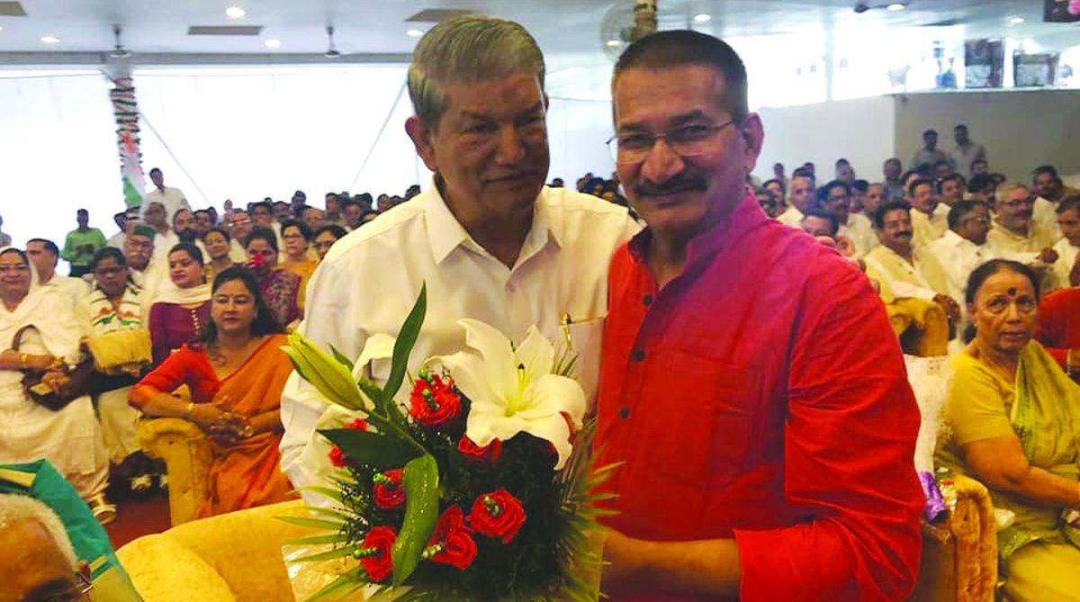 Congress national general secretary Harish Rawat with former PCC chief Kishore Upadhyaya in Dehradun on Monday. (Photo: IANS)