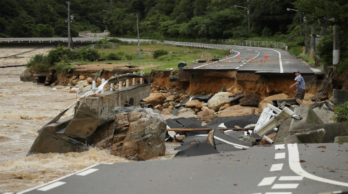 This picture shows a collapsed road due to heavy rain in Higashihiroshima, Hiroshima prefecture on July 7, 2018. Three people were found dead near rain-swollen rivers in Japan on July 6, officials said, as record downpours prompted authorities to order more than 210,000 people to evacuate their homes, with some areas hit by more than a metre of rainfall. Photo | AFP