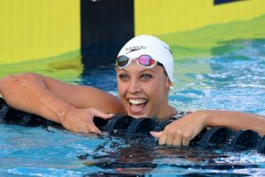 Baker breaks 100m backstroke world record