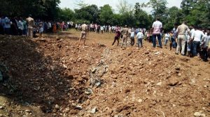 Kangra: People gather at the site where a MiG-21 aircraft crashed in Patta Jattian village of Himachal Pradesh's Kangra district, on July 18, 2018. (Photo: IANS)