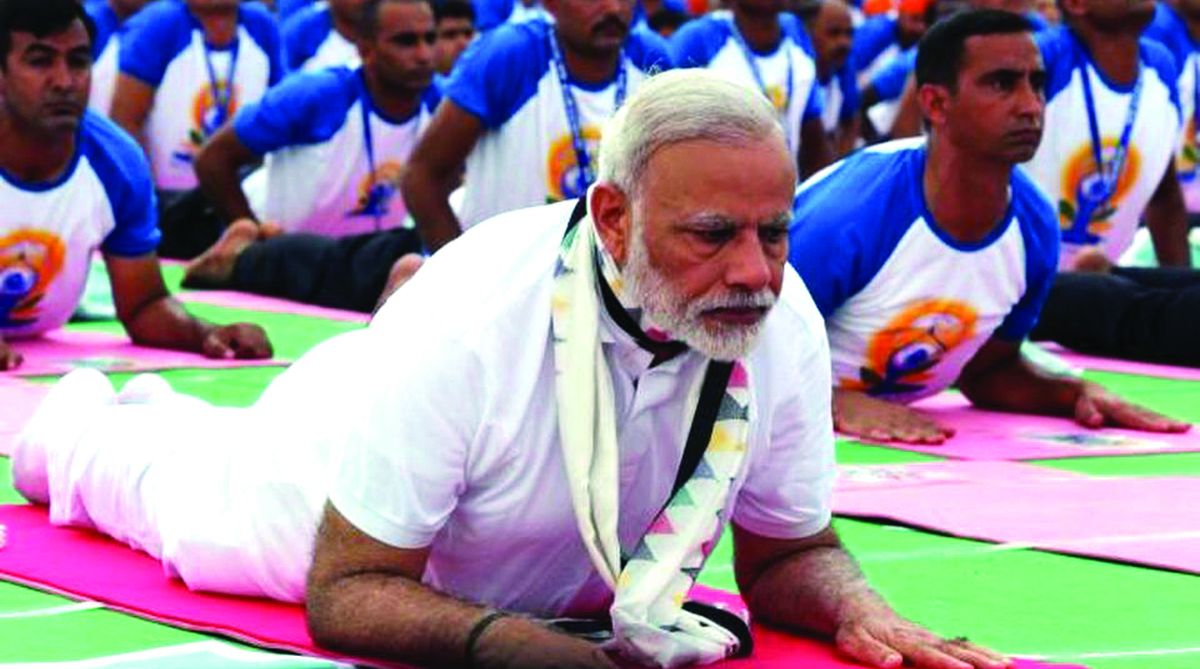 Prime Minister Narendra Modi participates in the mass yoga demonstration, on the occasion of the 4th International Day of Yoga 2018, at the Forest Research Institute, in Dehradun, Uttarakhand on Thursday.