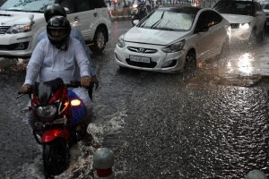 Heavy rains bring respite, traffic jams in Delhi