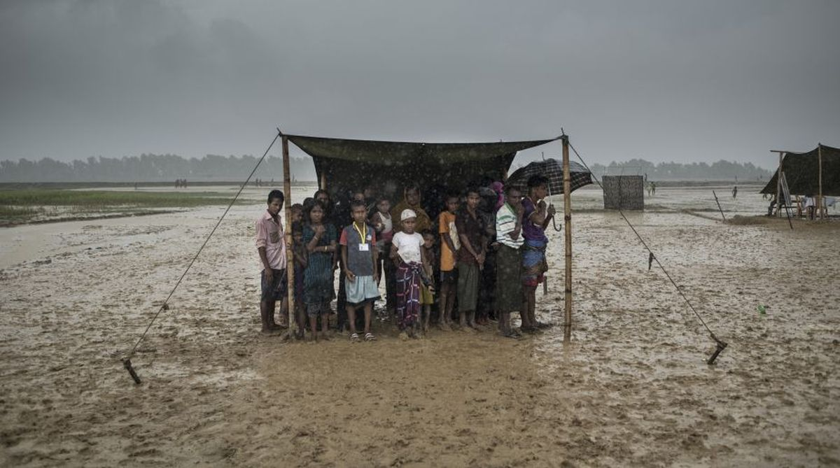 A file photo of Rohingya refugees taking shelter from rain at the Nayapara refugee camp in Bangladesh's Ukhia district in October 2017. (Photo: AFP)