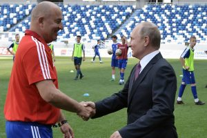 Putin awards football coach Cherchesov with Alexander Nevsky Order